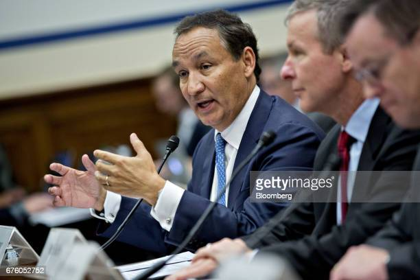 Oscar Munoz chief executive officer of United Continental Holdings Inc speaks as Scott Kirby president of United Continental Holdings listens during...