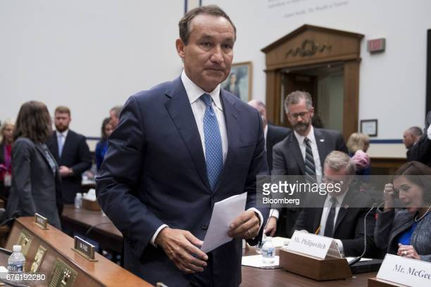 Oscar Munoz chief executive officer of United Continental Holdings Inc exits after a House Transportation and Infrastructure Committee hearing in...
