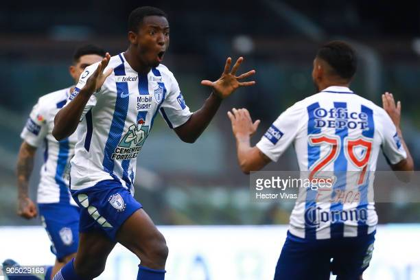 Oscar Murillo of Pachuca celebrates with teammate Franco Jara after scoring the equalizer during the second round match between America and Pachuca...