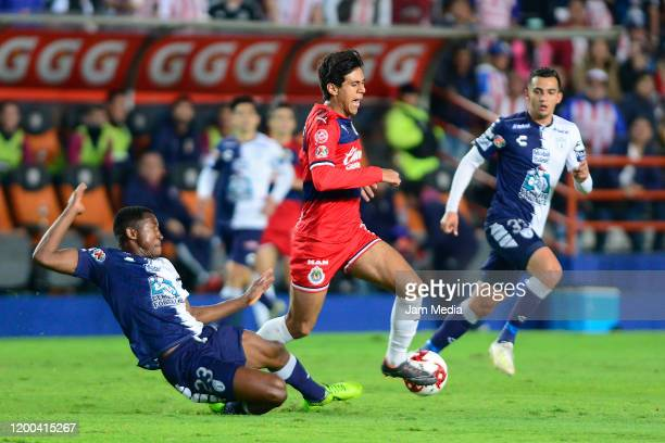 Oscar Murillo of Pachuca fights for the ball with Jose Macias of Chivas during the 2nd round match between Pachuca and Chivas as part of the Torneo...