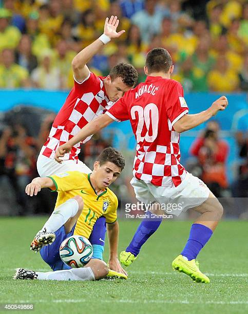 Oscar of Brazil competes for the ball against Croatia defenders during the 2014 FIFA World Cup Brazil Group A match between Brazil and Croatia at...