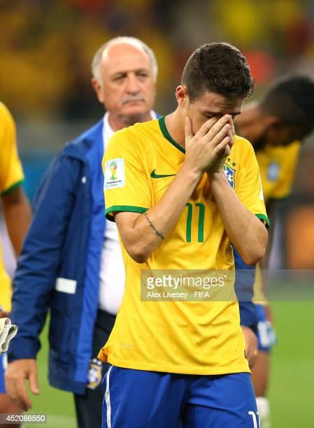 Oscar of Brazil is consoled by head coach Luiz Felipe Scolari after the 17 defeat in the 2014 FIFA World Cup Brazil Semi Final match between Brazil...