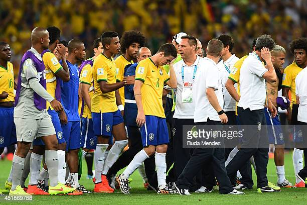 Oscar of Brazil reacts with teammates after being defeated 71 by Germany during the 2014 FIFA World Cup Brazil Semi Final match between Brazil and...