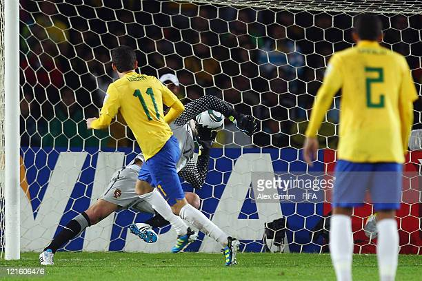 Oscar of Brazil scores his team's second goal against goalkeeper Mika of Portugal during the FIFA U20 World Cup 2011 final between Brazil and...