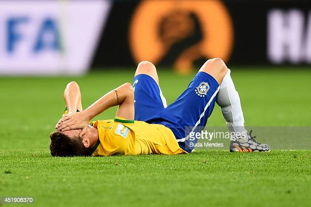Oscar of Brazil shows his dejection after the 2014 FIFA World Cup Brazil Semi Final match between Brazil and Germany at Estadio Mineirao on July 8...