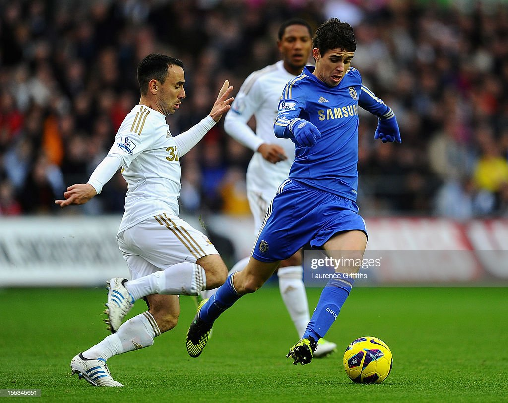 Oscar of Chelsea battles with Leon Britton of Swansea during the Barclays Premier League match between Swansea City and Chelsea at Liberty Stadium on November 3, 2012 in Swansea, Wales.