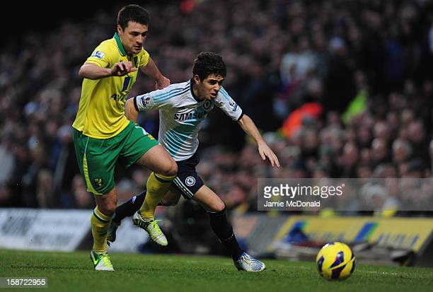 Oscar of Chelsea battles with Russell Martin of Norwich City during the Barclays Premier League match between Norwich City and Chelsea at Carrow Road...