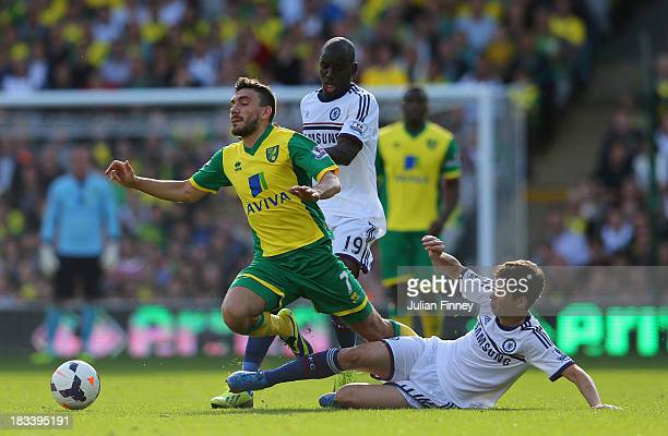 Oscar of Chelsea brings down Robert Snodgrass of Norwich City during the Barclays Premier League match between Norwich City and Chelsea at Carrow...