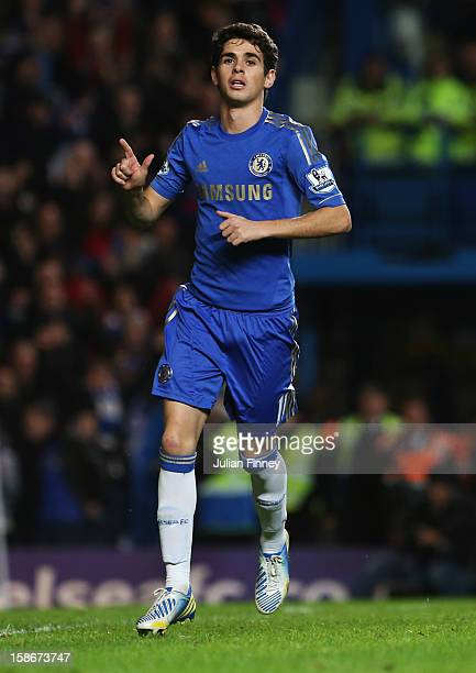 Oscar of Chelsea celebrates as he scores their sixth goal from the penalty spot during the Barclays Premier League match between Chelsea and Aston...