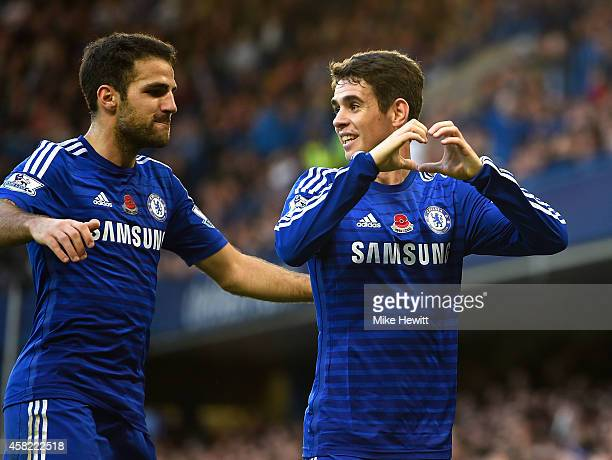 Oscar of Chelsea celebrates his goal with Cesc Fabregas during the Barclays Premier League match between Chelsea and Queens Park Rangers at Stamford...