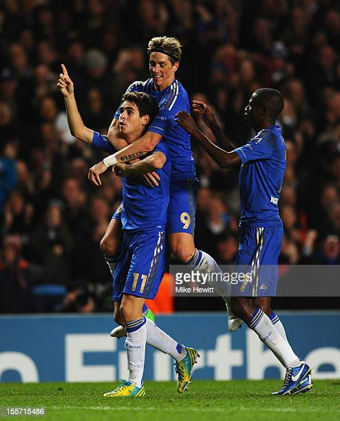Oscar of Chelsea celebrates his goal with Fernando Torres and Ramires during the UEFA Champions League Group E match between Chelsea and Shakhtar...
