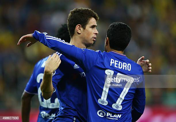 Oscar of Chelsea celebrates scoring his teams third goal with Pedro Rodriguez of Chelsea during the UEFA Champions League Group G match between...
