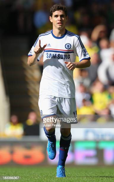 Oscar of Chelsea celebrates scoring the opening goal during the Barclays Premier League match between Norwich City and Chelsea at Carrow Road on...