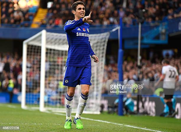 Oscar of Chelsea celebrates scoring the opening goal during the Barclays Premier League match between Chelsea and Queens Park Rangers at Stamford...