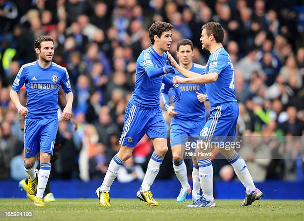 Oscar of Chelsea celebrates the equalising goal an own goal by Matthew Kilgallon of Sunderland with Cesar Azpilicueta during the Barclays Premier...