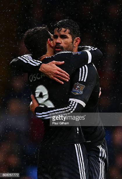 Oscar of Chelsea celebrates with teammateDiego Costa of Chelsea after scoring the opening goal during the Barclays Premier League match between...