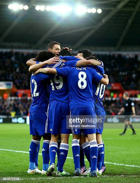 Oscar of Chelsea celebrates with teammates after scoring his team's fourth goal during the Barclays Premier League match between Swansea City and...