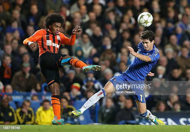 Oscar of Chelsea challenges Willian of Shakhtar Donetsk during the UEFA Champions League Group E match between Chelsea and Shakhtar Donetsk at...