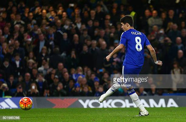 Oscar of Chelsea converts the penalty to score his team's third goal during the Barclays Premier League match between Chelsea and Sunderland at...