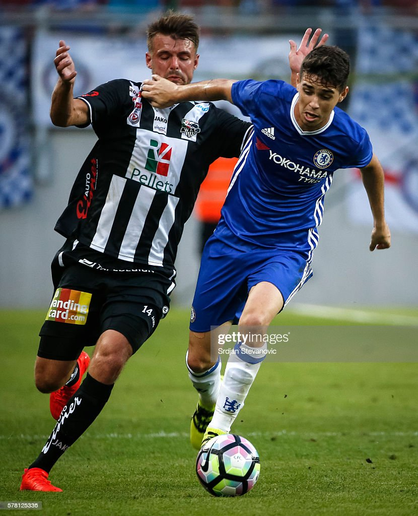 Oscar (R) of Chelsea in action against Philipp Prosenik (L) of WAC RZ Pellets during the friendly match between WAC RZ Pellets and Chelsea F.C. at Worthersee Stadion on July 20, 2016 in Velden, Austria.