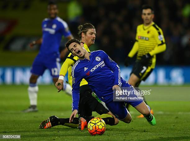 Oscar of Chelsea is brought down by Sebastian Prodl of Watford during the Barclays Premier League match between Watford and Chelsea at Vicarage Road...