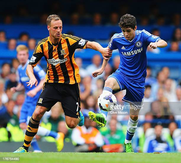 Oscar of Chelsea is challenged by David Meyler of Hull City during the Barclays Premier League match between Chelsea and Hull City at Stamford Bridge...