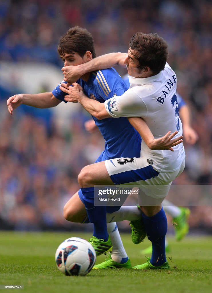 Oscar of Chelsea is tackled by Leighton Baines of Everton during the Barclays Premier League match between Chelsea and Everton at Stamford Bridge on May 19, 2013 in London, England.