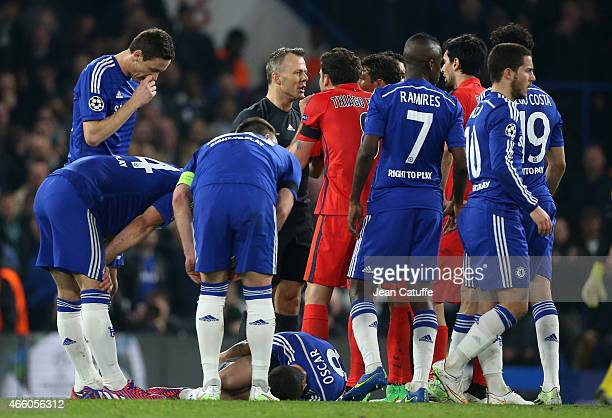 Oscar of Chelsea lies down while Thiago Motta and PSG players argue with referee Bjorn Kuipers after he sent off Zlatan Ibrahimovic of PSG during the...
