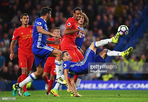 Oscar of Chelsea makes a spectacular attempt to reach the ball during the Premier League match between Chelsea and Liverpool at Stamford Bridge on...
