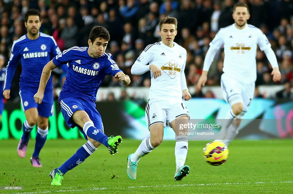 Oscar of Chelsea scores his team's first goal during the Barclays Premier League match between Swansea City and Chelsea at Liberty Stadium on January 17, 2015 in Swansea, Wales.