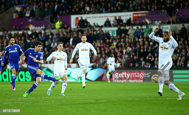Oscar of Chelsea scores his team's first goal during the Barclays Premier League match between Swansea City and Chelsea at Liberty Stadium on January...