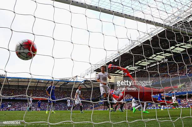 Oscar of Chelsea scores his team's first goal past Lukasz Fabianski of Swansea City during the Barclays Premier League match between Chelsea and...