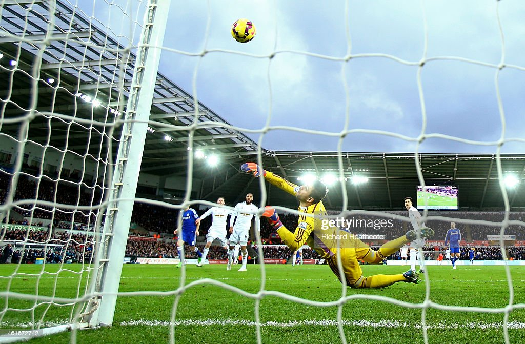 Oscar of Chelsea scores his team's fourth goal past Lukasz Fabianski of Swansea City during the Barclays Premier League match between Swansea City and Chelsea at Liberty Stadium on January 17, 2015 in Swansea, Wales.