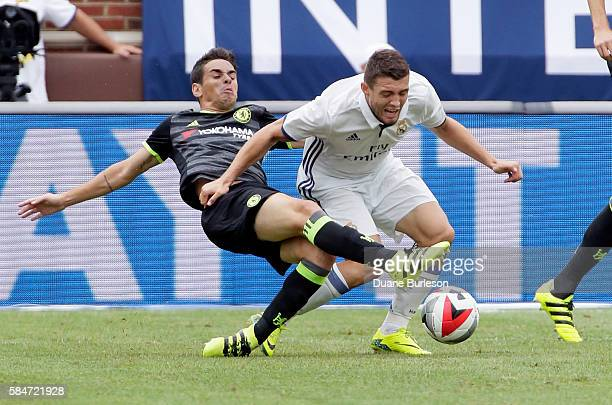 Oscar of Chelsea steals the ball from Mateo Kovacic of Real Madrid at Michigan Stadium on July 30 2016 in Ann Arbor Michigan