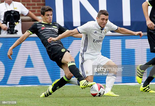 Oscar of Chelsea steals the ball from Mateo Kovacic of Real Madrid during the first half at Michigan Stadium on July 30 2016 in Ann Arbor Michigan