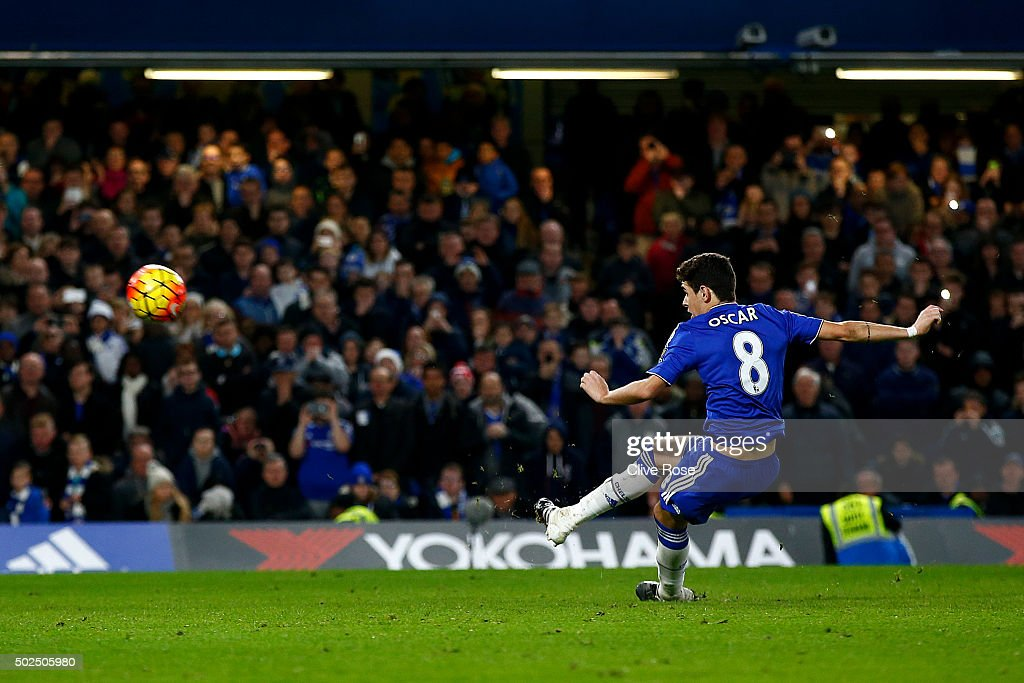 Oscar of Chelsea watches the ball fly over the bar as he slips taking a penalty during the Barclays Premier League match between Chelsea and Watford at Stamford Bridge on December 26, 2015 in London, England.