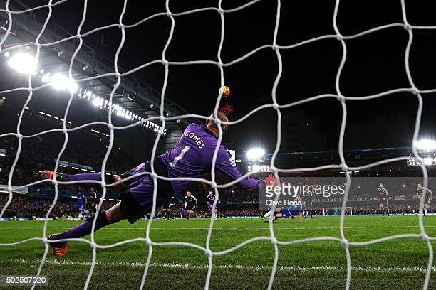 Oscar of Chelsea watches the ball fly over the bar as he slips taking a penalty during the Barclays Premier League match between Chelsea and Watford...