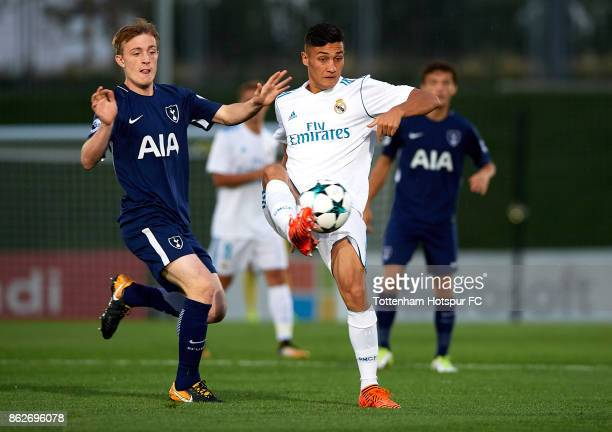 Oscar of Real Madrid competes for the ball with Oliver Skipp of Tottenham Hotspur during the UEFA Youth Champions League group H match between Real...
