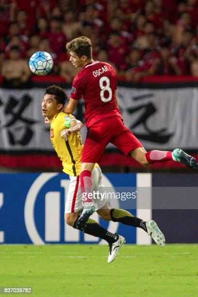 Oscar of Shanghai SIPG and Zheng Zhi of Guangzhou Evergrande compete for the ball during 2017 AFC Champions League 2017 Quarterfinals 1st leg between...