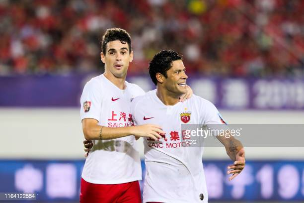 Oscar of Shanghai SIPG celebrates with Hulk after scoring a goal during the 2019 Chinese Football Association Cup quarterfinal match between...