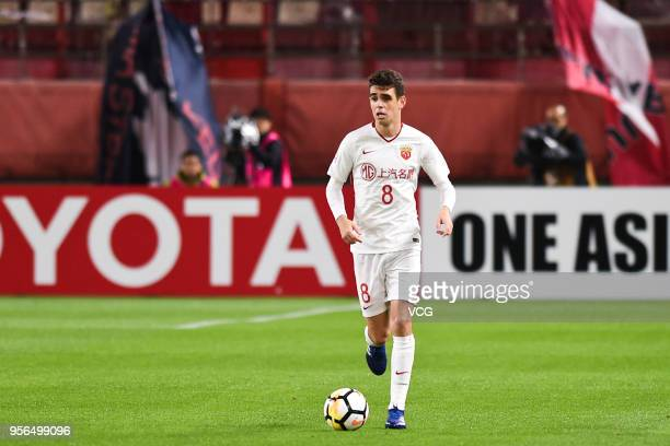 Oscar of Shanghai SIPG drives the ball during the AFC Champions League Round of 16 first leg match between Kashima Antlers and Shanghai SIPG at...