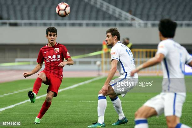 Oscar of Shanghai SIPG kicks the ball during the eighth round match of 2017 Chinese Football Association Super League between Shanghai SIPG and...