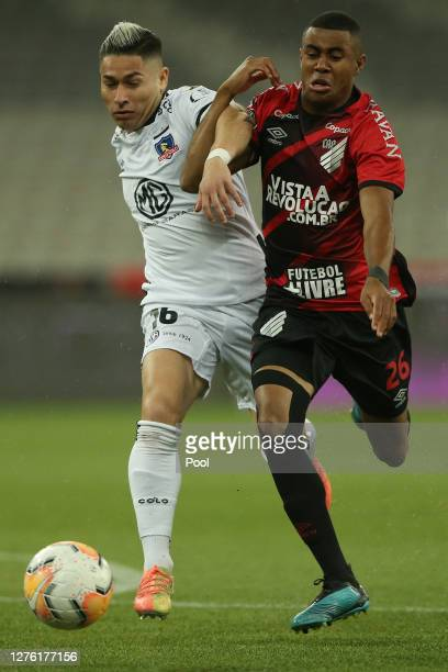 Oscar Opazo of ColoColo fights for the ball with Erick of Athletico Paranaense during a group C match of Copa CONMEBOL Libertadores 2020 between...