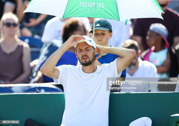 Oscar Otte of Germany suffers in the heat during the Men's final between Sergiy Stakhovsky of the Ukraine and Oscar Otte of Germany on day Eight of...