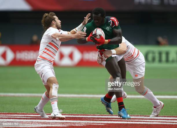 Oscar Ouma of Kenya is tackled by Dan Bibby of England during the Canada Sevens the Sixth round of the HSBC Sevens World Series at the BC Place...