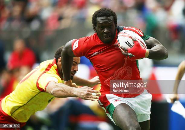 Oscar Ouma of Kenya runs the ball by Inaki Villanueva of Spain during the Canada Sevens the Sixth round of the HSBC Sevens World Series at the BC...