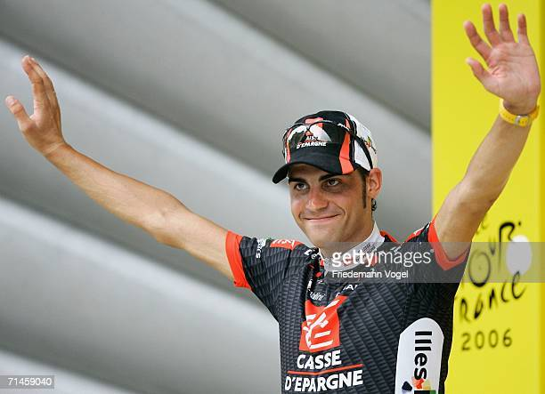 Oscar Pereiro Sio of Spain and Caisse D'Epargne celebrates his yellow jersey as overall leader on the podium after Stage 14 of the 93rd Tour de...