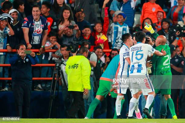 Oscar Perez goalkeeper of Pachuca celebrates with teammates after scoring the second goal of his team during a match between Pachuca and Cruz Azul as...