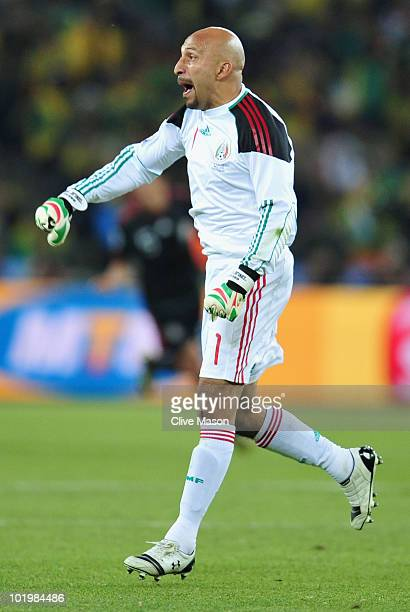 Oscar Perez of Mexico celebrates after Rafael Marquez of Mexico scored the second goal to equalise during the 2010 FIFA World Cup South Africa Group...