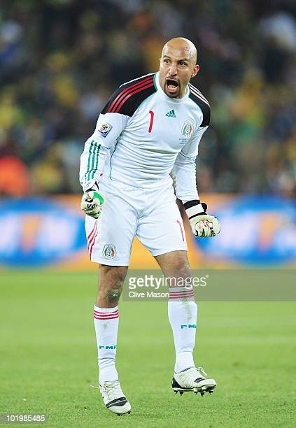 Oscar Perez of Mexico celebrates his side equalising goal during the 2010 FIFA World Cup South Africa Group A match between South Africa and Mexico...